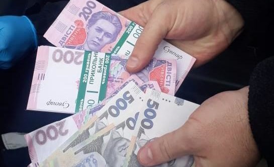 Фальшиві купюри по 200 гривень: подробиці затримання шахраїв на Волині. ФОТО